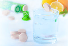 Multivitamin tablets. Multivitamin tablet in water with lemon and orange Stock Image