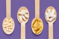 Healthy Supplements on purple background royalty free stock photo