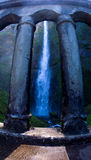 Multnoma falls. Multnomah falls is framed by the stone columns of a small bridge crossing its path Stock Image