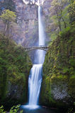 Multnoma falls. Multnomah falls is framed by a small footbridge crossing its path Stock Photography