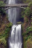 Multnomah Falls with Bridge. Bridge over Multnomah falls.  Lower falls in the foreground, upper falls in the background Stock Photos