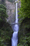 Multnomah Falls and foot bridge in lush green setting near Mount Hood and Portland Oregon in the Columbia River Gorge region Royalty Free Stock Photos