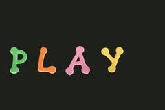 Multocoloured bokstäver för ordlek Arkivbild
