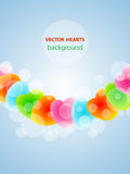 Multu-coloured hearts. Red green blue hearts with bokeh Royalty Free Stock Photos
