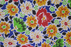 Multy-colors and floral patterns. The sample of cotton fabric: bright multy colors and floral patterns. Lightweight, absorbent fabric for sewing summer clothes Royalty Free Stock Images