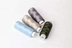 Multy coloured bobbins of thread on white Royalty Free Stock Images