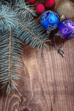 Multycolored christmas balls with pinetree branch on old wooden Stock Photos