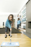 Mum And Daughters Cleaning Living Stock Photography