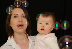 Mum and baby watching bubbles Stock Photography