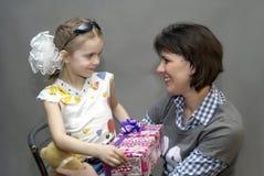 At mum birthday. The little girl wishes  mum happy birthday Stock Image