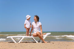 Mum and child on a beach stock images