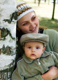 Mum and the child in a birch wood. Stock Images