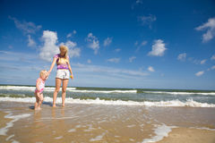 Mum and child on the seashore Stock Images