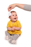 Mum combing baby girls hair. Cutout Royalty Free Stock Images