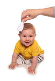 Mum combing baby girls hair. Cutout Stock Images