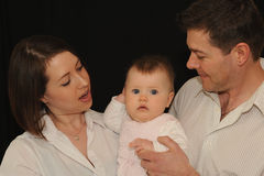 Mum and dad with baby girl Royalty Free Stock Photography