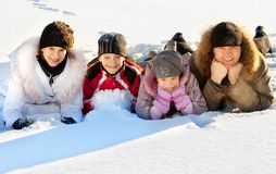 Mum dad an children in the winter Stock Photography