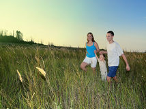 Happy family run in the field Royalty Free Stock Photography