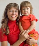 Mum with a daughter. Mum holds on hands of the child stock images
