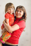 MUM WITH A DAUGHTER. Mum holds the daughter on hands royalty free stock images