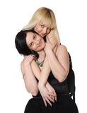 Mum and the daughter. Two young attractive women on a white background Royalty Free Stock Photo