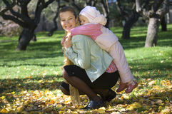 Mum and daughter. Mum and a daughter play together, walk in park Royalty Free Stock Photography