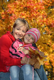 Mum with a daughter in autumn park Royalty Free Stock Image