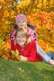 Mum with a daughter in autumn park Stock Photo