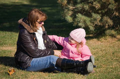 Mum with a daughter in autumn park Stock Images