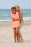 Mum with  daughter on a beach Stock Image