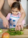 Mum and Daughter Chopping Veggies Stock Photos