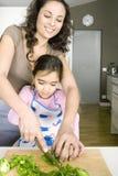 Mum and Daughter Chopping Veggies Royalty Free Stock Photo