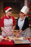 Mum and daughter at christmas baking Royalty Free Stock Photo