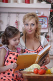 Mum with a daughter and a cookbook Royalty Free Stock Image