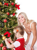 Mum with a daughter decorate christmas tree. Stock Photos