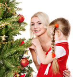 Mum with a daughter decorate christmas tree. Royalty Free Stock Photography