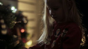 Mum with a daughter decorate a Christmas tree stock video footage