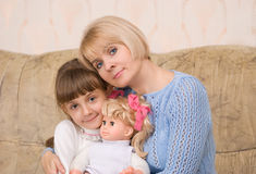 Mum and daughter with a doll Royalty Free Stock Image