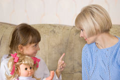 Mum and daughter with a doll Royalty Free Stock Photography
