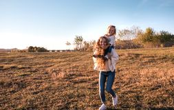 Mum and daughter having fun together outdoors. stock image