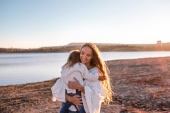 Mum and daughter having fun together outdoors. royalty free stock photo
