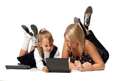 Mum and daughter with notebook Royalty Free Stock Photo