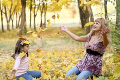 Mum and daughter in park. Royalty Free Stock Image