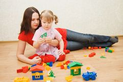 Mum with the daughter plaing at home Royalty Free Stock Photo