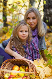 Mum and the daughter play autumn park Royalty Free Stock Photo