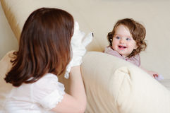 Mum and daughter play puppet show stock photo