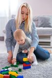 Mum with the daughter play to a room Royalty Free Stock Photography