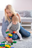 Mum with the daughter play to a room Stock Photography