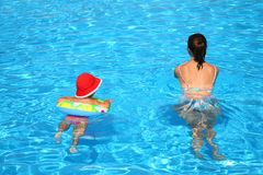 Mum and daughter in a pool Royalty Free Stock Image