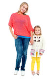 Mum and daughter posing in trendy outfits Stock Photos